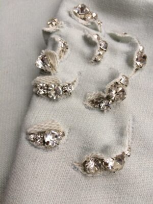 Organic cotton sweater crystal rose detail